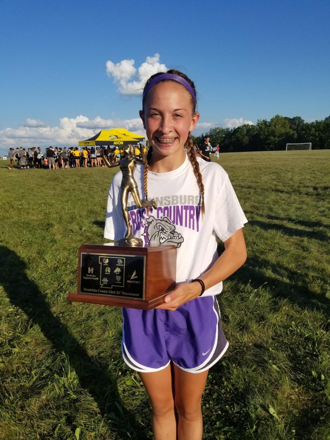 Freshman Abby Lynch with her County Champ trophy.  Photo courtesy of @BHSDogsgirlsxc