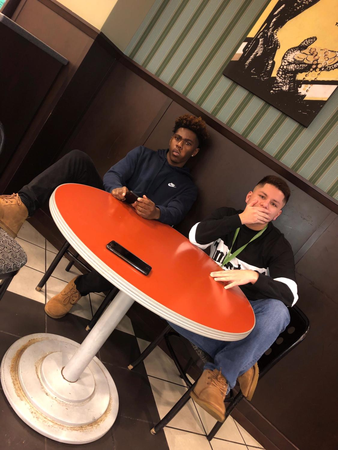 Senior Halim Tienda (right) sits with a friend.